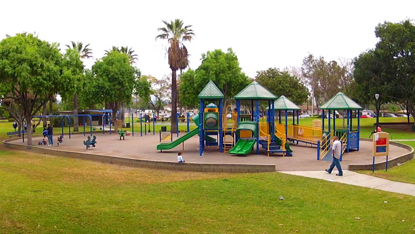 WHITTIER, CA/USA: April 23, 2013- Wide angle shot of a playground area at a city park circa 2013 in Whittier. Unsupervised children at city parks can become targets for abduction.
