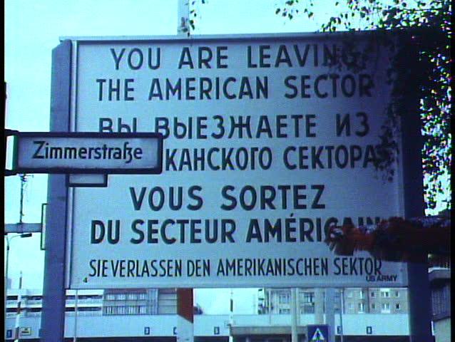 "BERLIN - GERMANY - CIRCA - 1988: Berlin, Germany, The Berlin Wall in 1988, sign ""Leaving American Zone,"" close, zoom wide"