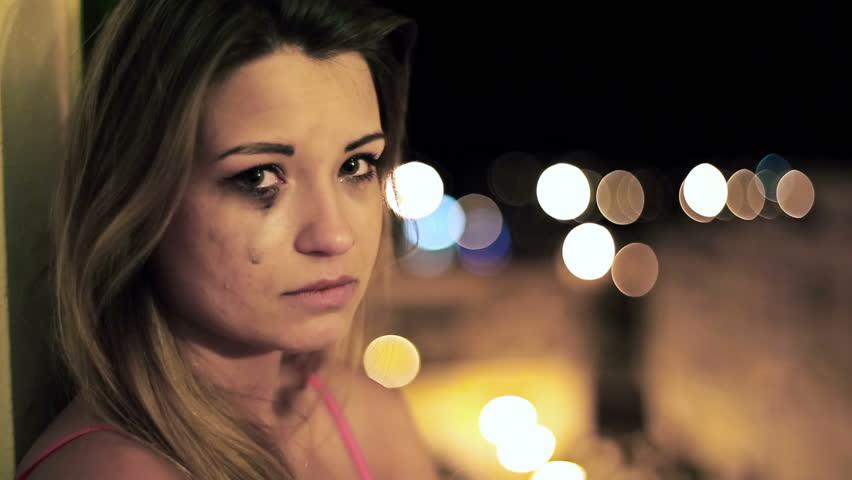 Beautiful sad woman crying in the night