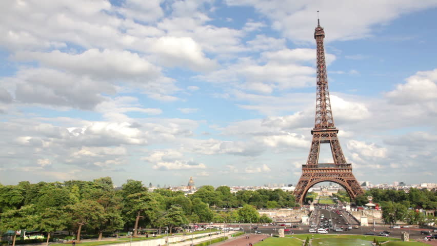 Eiffel Tower, Paris, France, Europe. View of the famous travel and tourism icon at daytime in summer / spring with blue sky,