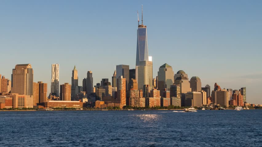 Time lapse of day changing to night over the Freedom Tower and Downtown Manhattan as seen across the Hudson River from Hoboken, NJ in June of 2013.