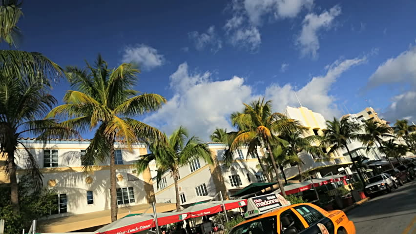 P.O.V. driving Miami Art Deco District Ocean Drive colorful hotels and condominiums South Beach, Florida, USA #4231390