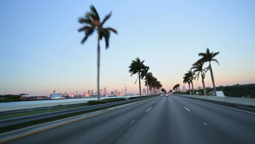 Point of view driving on MacArthur Causeway towards Miami downtown, Florida, USA