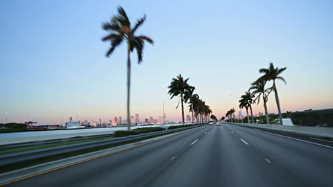 Point of view driving on MacArthur Causeway towards Miami downtown, Florida, USA