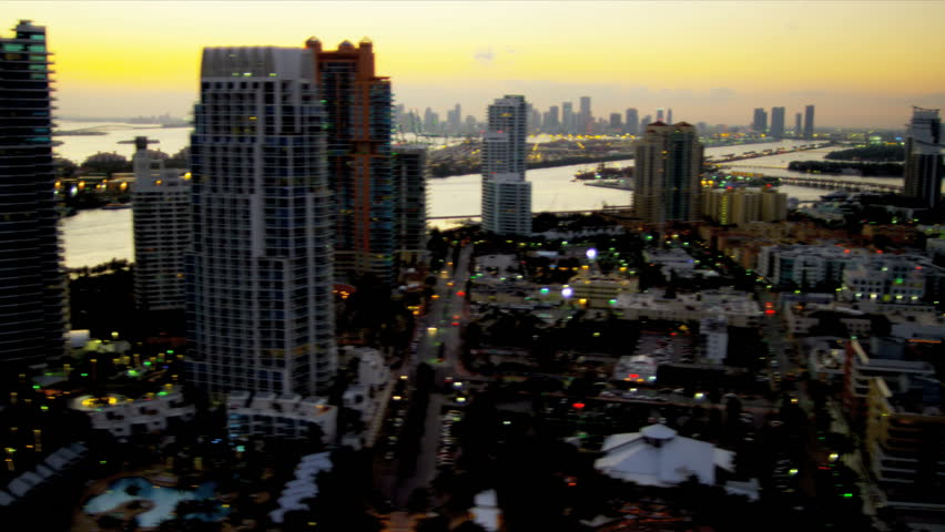 Aerial illuminated view South Beach Resort Art Deco hotels and condominiums, Miami, Biscayne Bay, Florida, USA, RED EPIC