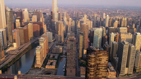Aerial sunrise view downtown Chicago River, skyscrapers, Trump Tower, marina district, Chicago, Illinois, USA, shot on RED EPIC