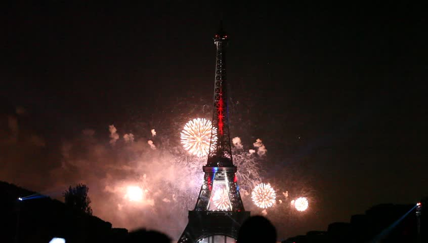 PARIS - JULY 14: night fireworks at the Eiffel Tower in the National Holiday, also known as Bastille Day, July 14, 2013 in Paris France