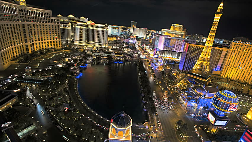 Las Vegas - January 2013: Illuminated view Bellagio Hotel nr Caesars Palace, Las Vegas Strip, USA, Time Lapse | Shutterstock HD Video #4262600