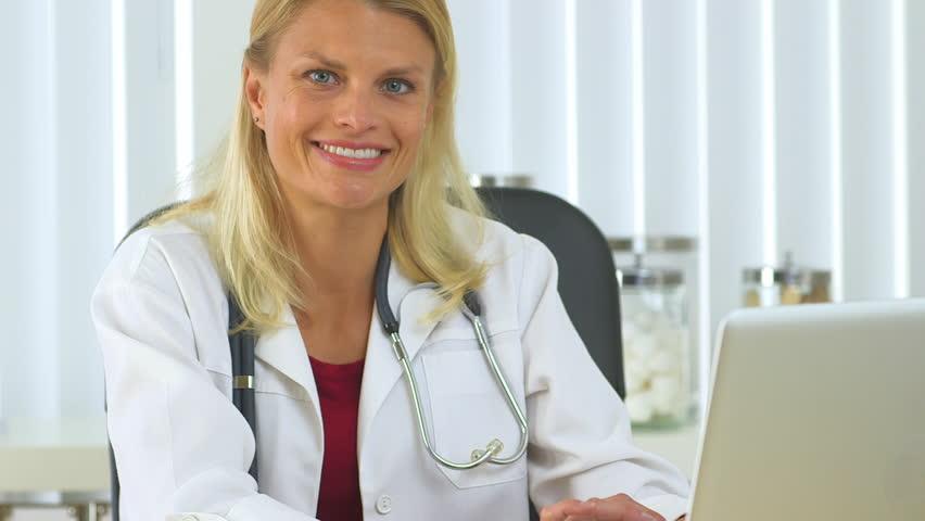 Confident female doctor   Shutterstock HD Video #4273250