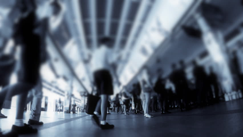Timelapse  with tilt shift effect of people boarding trains at a metro busy metro station