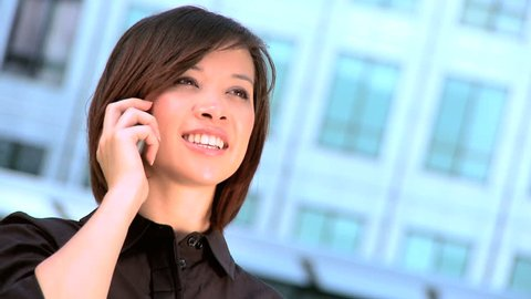 Smart city businesswoman talking on a mobile(cell) phone