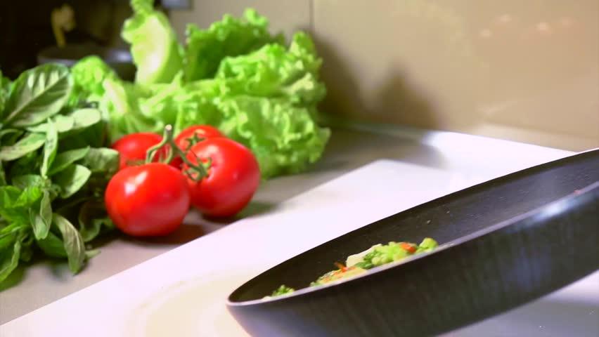 Cooking Vegetables. Frying Pan. Preparing Vegetarian Food. Slow Motion Video Footage