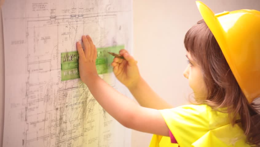 A child constructor architect looking at building plans, speaking to talkie walkie, measuring, drawing and calculating.