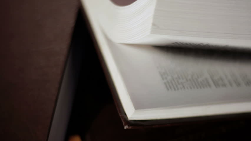 Flipping pages of a book. | Shutterstock HD Video #4307630