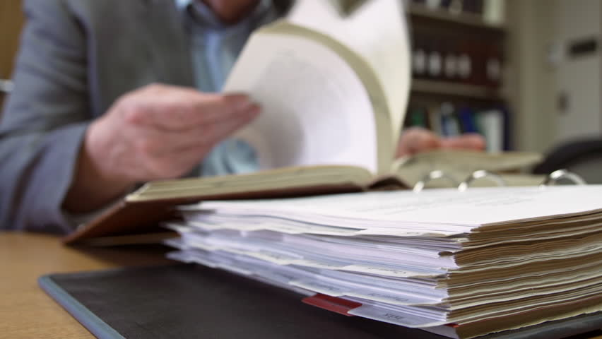 Man conducts legal research in library