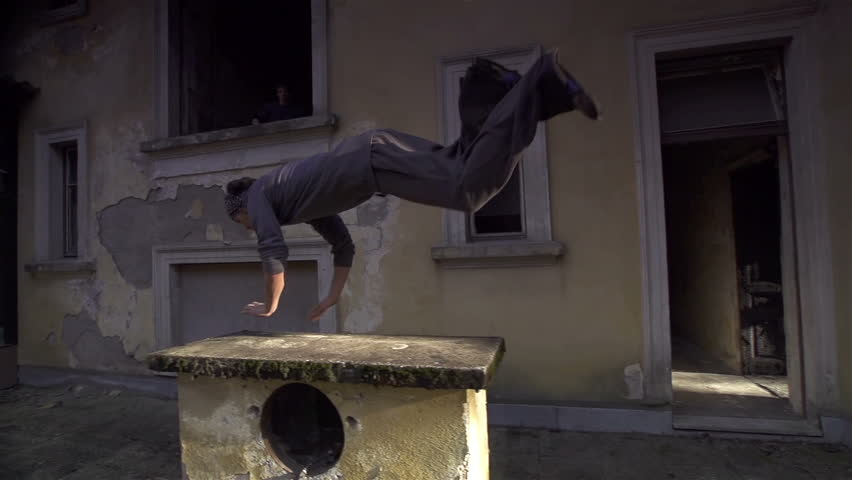 SLOW MOTION: Free runners running through abandoned house