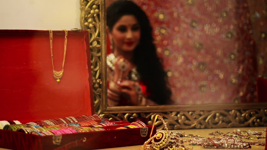 Shot of a Indian bridal doing make-up