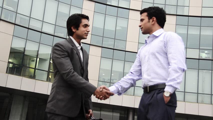 Shaky shot of two businessmen shaking hands