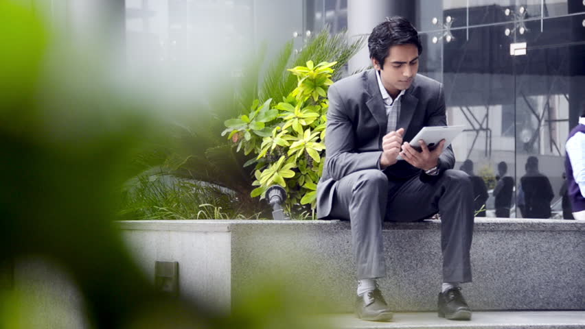 Shot of a businessman using a digital tablet | Shutterstock HD Video #4330100