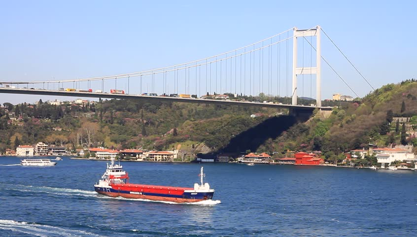 Tanker ship cruising under the bridge. Bosphorus Sea, Istanbul, Turkey