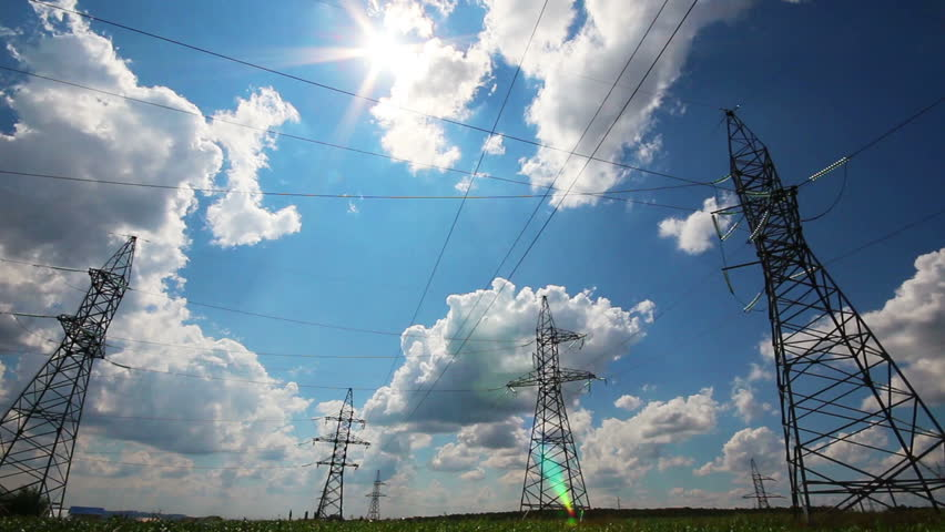 Tall electric masts against sun and cloudy sky - timelapse | Shutterstock HD Video #4357871