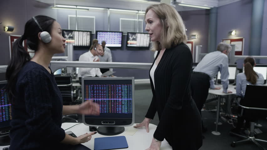 Busy multi ethnic team of financial traders working together and watching the world markets. | Shutterstock HD Video #4362722