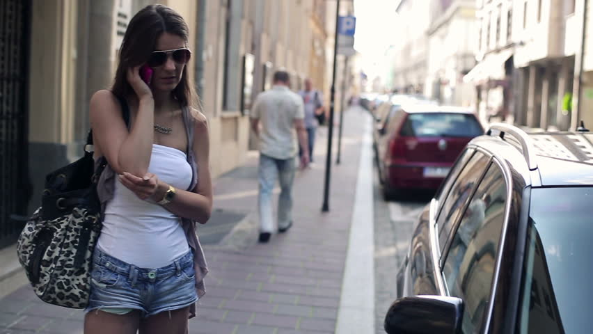 Attractive woman talking on mobile phone in the city