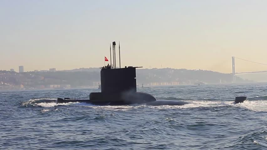 Navy Submarine. Close-up tracking shot. A submarine moving into Bosporus waters.
