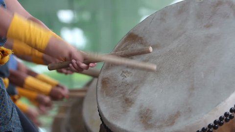 Detail clip of taiko drums being played.