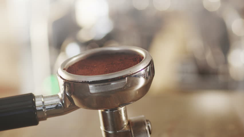 Tamping Fresh Ground Coffee. Shot on RED Digital Cinema Camera in 4K (ultra-high definition (UHD)), so you can easily crop, rotate and zoom, without losing quality!