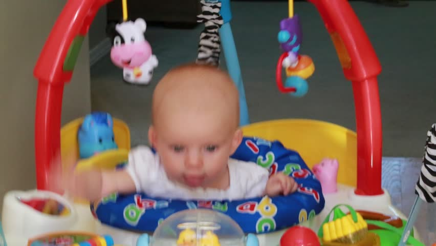 6e99e0dad Baby Playing in Large Jumper Stock Footage Video (100% Royalty ...