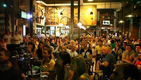 RIO DE JANEIRO, BRAZIL - JUNE 30: Cariocas (residents of Rio) in pub cheer their team as Brazil wins the Confederations Cup against Spain 3:0. Rio de Janeiro, Brazil, June 30, 2013.