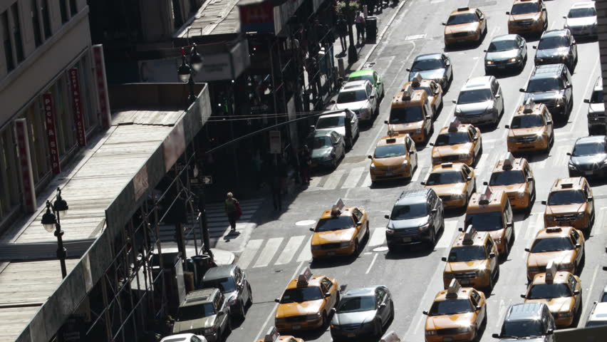Time lapse of traffic congestion and pedestrians on a busy New York City street. #4430300