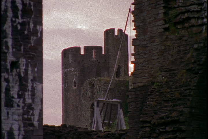 Towers of Caerphilly castle framed by stone walls in Caerphilly, South Wales.