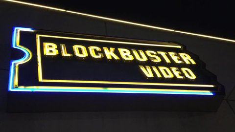LOS ANGELES - JULY 2013 - A BlockBuster Video store closes its door as its business model is no longer economically viable