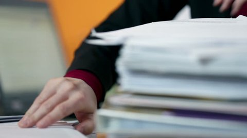 Close up on secretary searching through documents