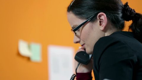 Business woman depressed over lost documents, making a call