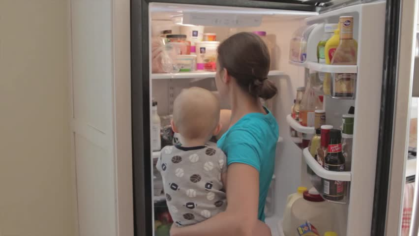 A mother with her baby boy while cooking in the kitchen
