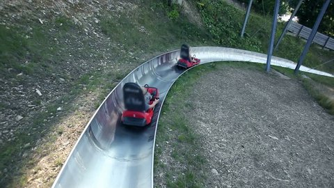 Young people driving by with bobsled