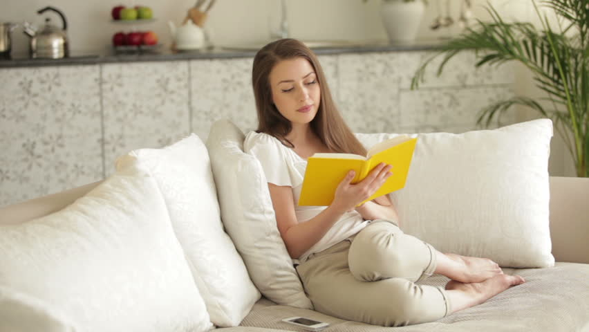 0d8b07157182 Cute Girl Sitting On Sofa Stock Footage Video (100% Royalty-free ...