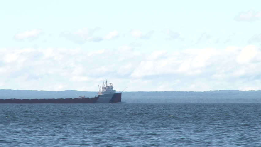 Lake Superior scenic on sunny, blue sky day with 1000 foot ore ship traveling