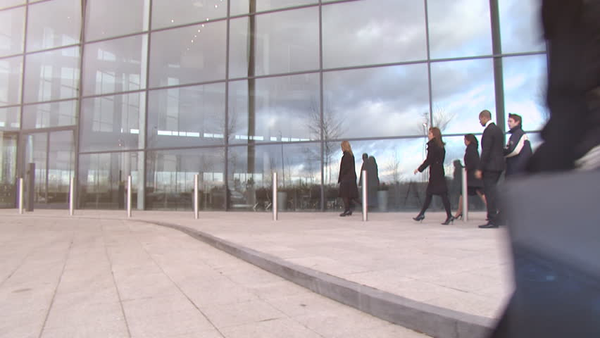 Large multi ethnic business group arrive at a large contemporary office building to begin their working day. High quality HD video footage | Shutterstock HD Video #4478816