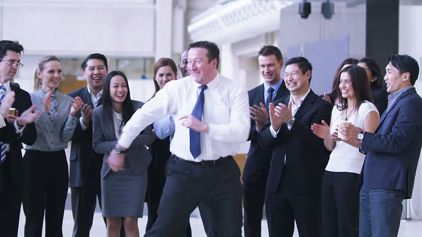 Funny dancing businessman. Excited group of business people clap their strange colleague.