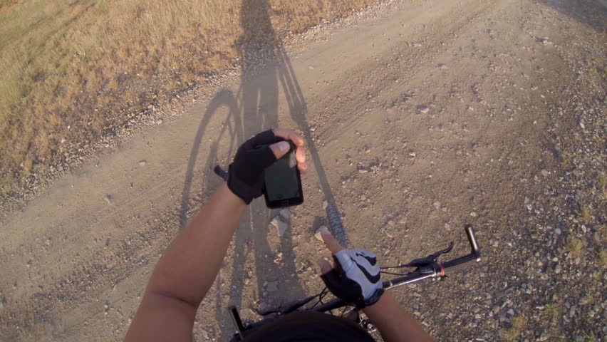 Mountain biker looking for route on smartphone using sports tracker app POV GoPro Hero3 BE