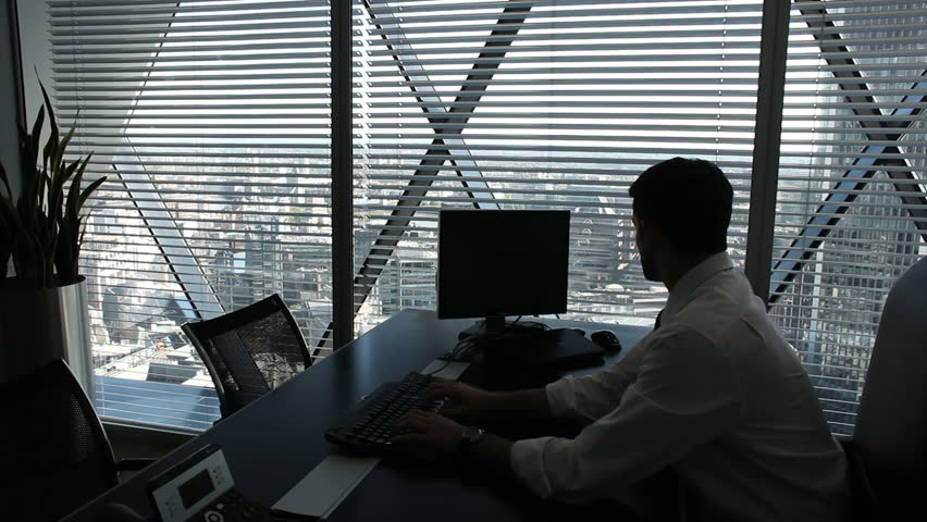 Executive Office View businessman looking over city view from executive office. high