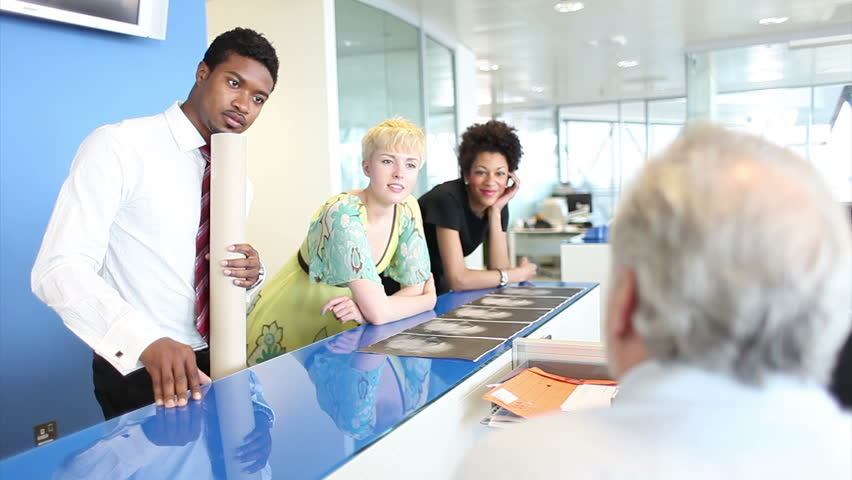 Business people in relaxed discussion area in office. High quality HD video footage | Shutterstock HD Video #4493171