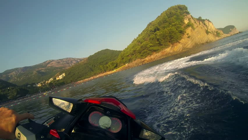 Extreme Jet Ski Driving - Operator's Point of View. Water sports. Man Riding a Jet Ski at Sunset. Jet Skiing.