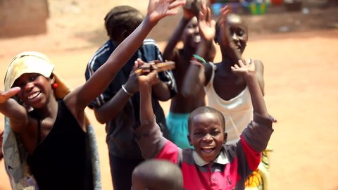 GAMBIA, 08 MARCH 2012: Group of young African children sing traditional song