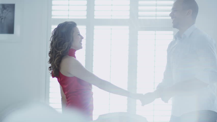 Happy and attractive young couple in love dance together in their stylish apartment. In slow motion. | Shutterstock HD Video #4533320