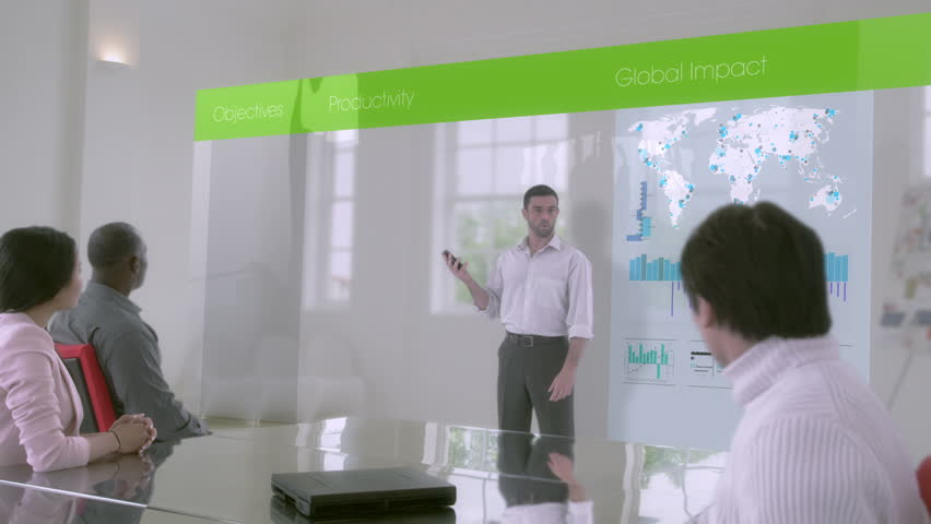 Confident young business team working on a project in an airy white office space